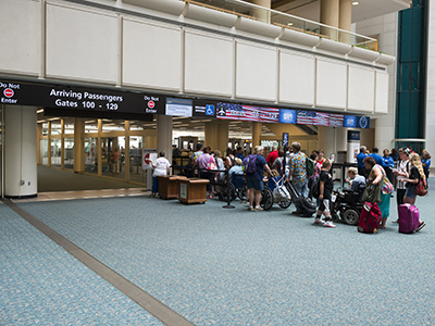 Orlando, Florida, USA - July 5, 2014: People wait in a line reserved for disabled passengers at a TSA security checkpoint in Orlando International Airport